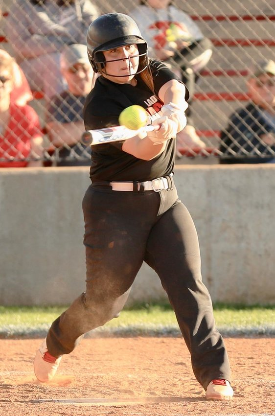 Purcell senior Hannah Buchanan hits a triple Monday evening against AmPo. Buchanan went 2-2 and scored Purcell's only run in the 15-1 loss.