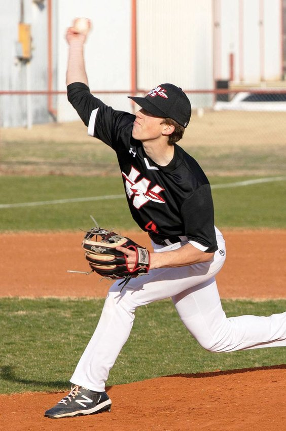 Washington senior Bobby Reese throws a pitch home. The Warriors are coming off a spring break trip to Gulf Shores, Ala.