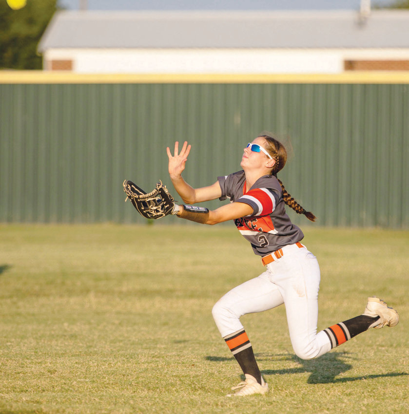 Wayne sophomore Haylee Durrence slides under a fly ball for an out Monday during the Bulldogs' 9-2 win over Asher. Durrence made several plays for Wayne in the outfield in the game.