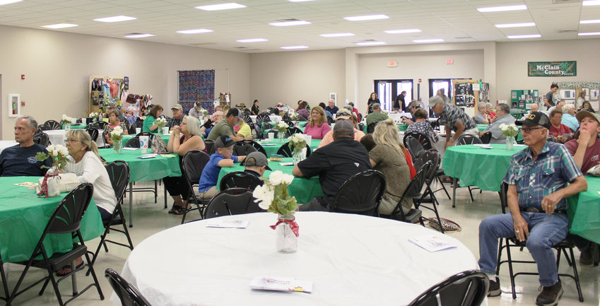 A bean supper and ice cream social drew a large crowd at the McClain County Fair. After the meal, the audience stayed to bid hundreds of dollars on winning entries in the pie, cake and salsa competition.Proceeds raised went to the county's scholarship fund for 4-H.