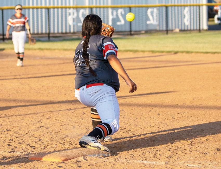 Wayne senior Mayce Trejo catches a ball at first base for an out. Wayne hosted the District tournament Wednesday.