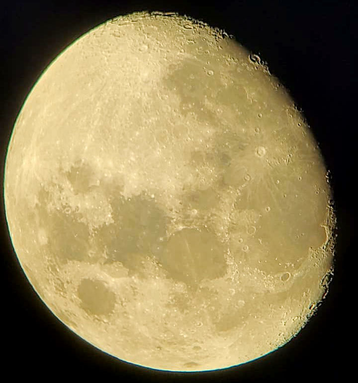 """Vernon Bullock captured a fantastic view of the moon with his cell phone through the viewer of one of the large telescopes at Saturday's """"Despicable Moon Party."""""""