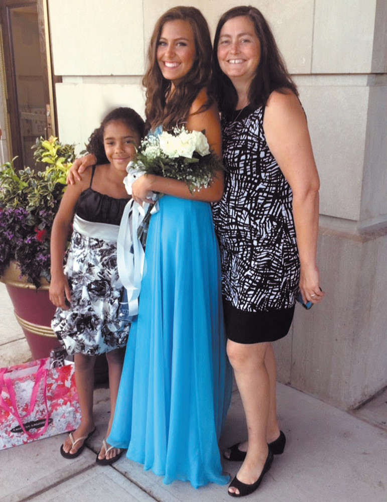FAMILY: From left, Capaldi's niece Neveah Noble and mom JoAnn show their support for Madeline  at the pageant.