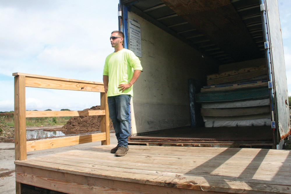 EASY DROP-OFF: City worker Larry Ferri is pictured outside the mattress-collecting site at the composting station behind Mickey Stevens Sports Complex.