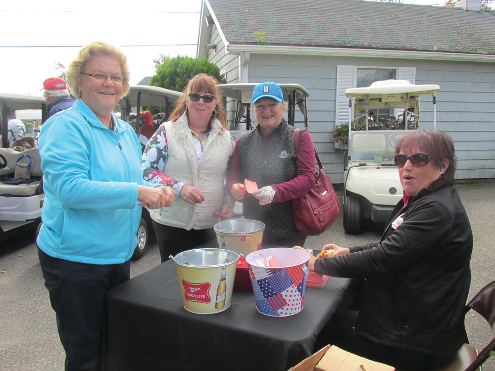 VALUABLE VOLS: This weekend's JMCE golf tournament will be made possible through the efforts of volunteers, such as those seen running the raffle table during last year's event.