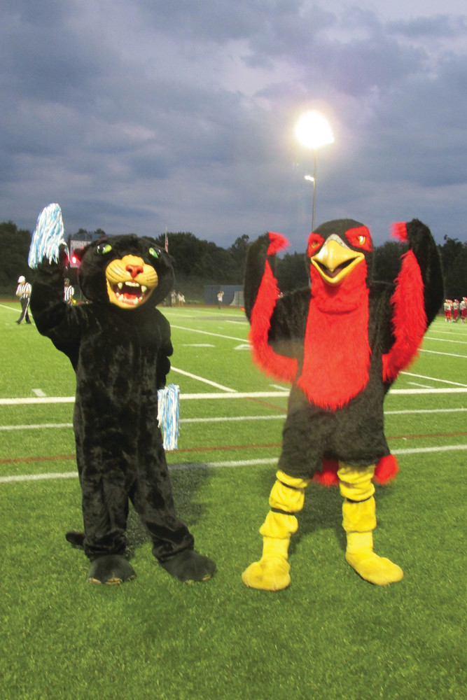 MIGHTY MASCOTS: Kathleen Jaroma, left, who proudly wears the Panther mascot outfit, joins Falcons mascot Matt Fyrer prior to last Friday's kick-off.