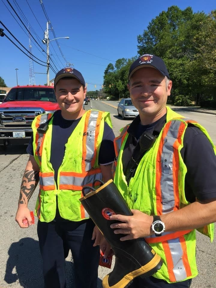 PROUD PALS: Among the Johnston firefighters who worked on this year's MDA drive were Josh Bloschichak and Chris Brandmeier.
