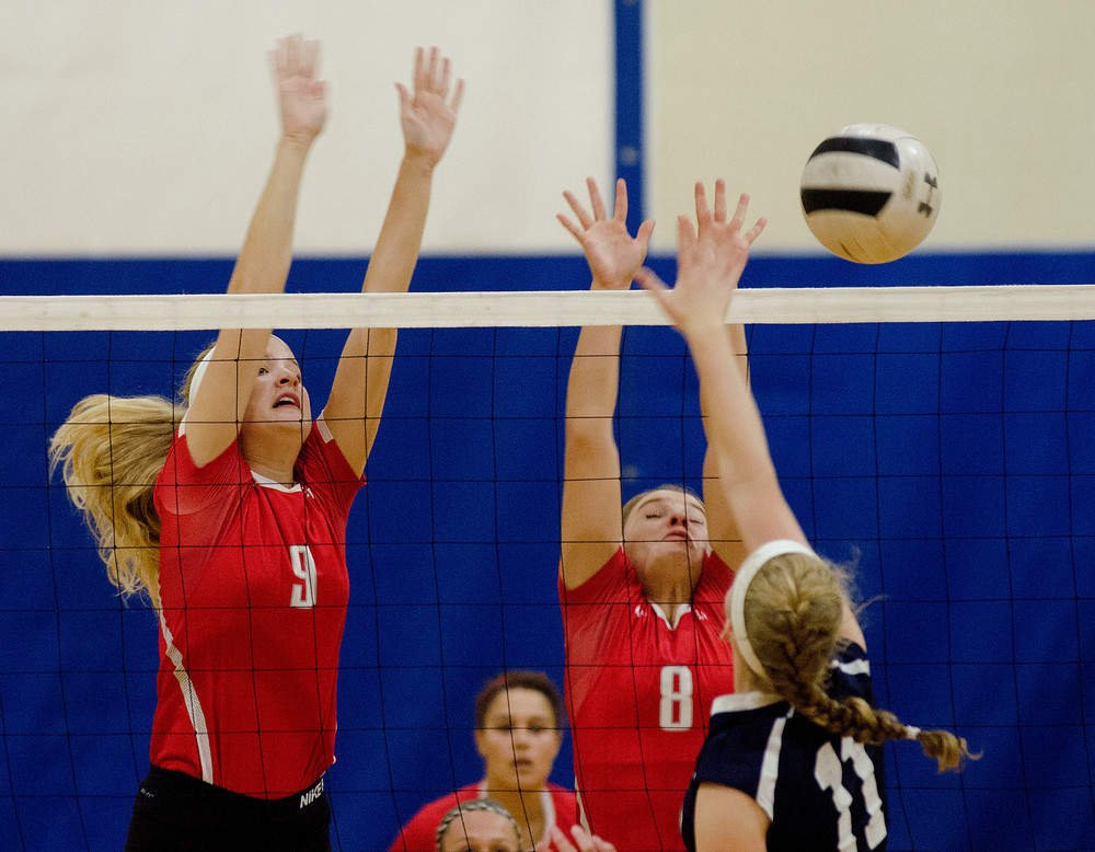 Townies teammates Patricia Hurley (left) and Ava Atwell attempt to block a volley.