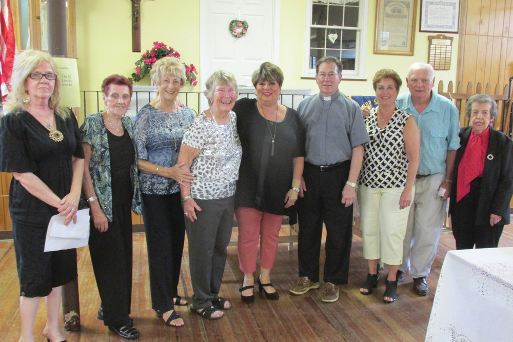 SUPER SUPPORTERS: Some of the parishioners who helped make the Italian Festival a success were Cindy Galipeau, Louisa Iannotti, Doris Haskins, sandy McCarthy, Rose DeLuca, Angela Fillipone, Josephine Gemma, Nadine Corona, and Sandy Cerrito. They are joined here by the Rev. Robert Rochon.