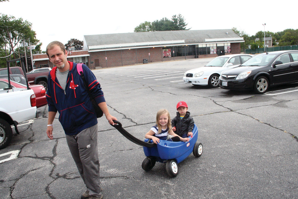 'NICE TO HAVE AN OPTION': Greg Phillips, who lives in the neighborhood of the planned Dave's Marketplace, knows the property well, as he worked there when it was a Hi-Lo market. He has in tow his daughter, Bella, a pre-schooler at Little Shepard across Pontiac Avenue from the proposed store, and his son, J.J., who is two years old.