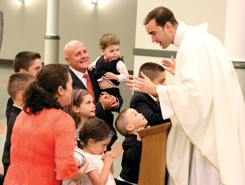 FROM ALTAR BOY TO PRIEST: Father Nathan Ricci leaves the Roman Catholic Cathedral of Saints Peter and Paul in Providence after being ordained as a priest June 25th.