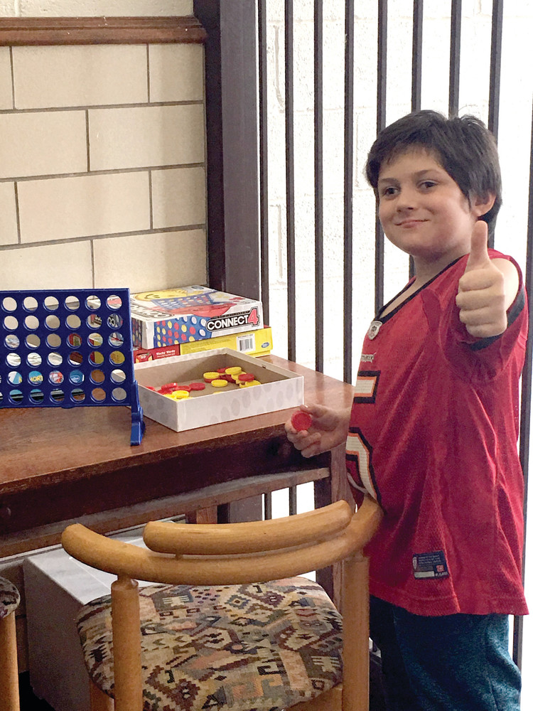 THUMBS UP FOR MENTORING: Gabe Santiago, a fourth-grader at Gladstone Elementary School, has nothing but great things to say about his mentor Marilyn and the time that they spend together.