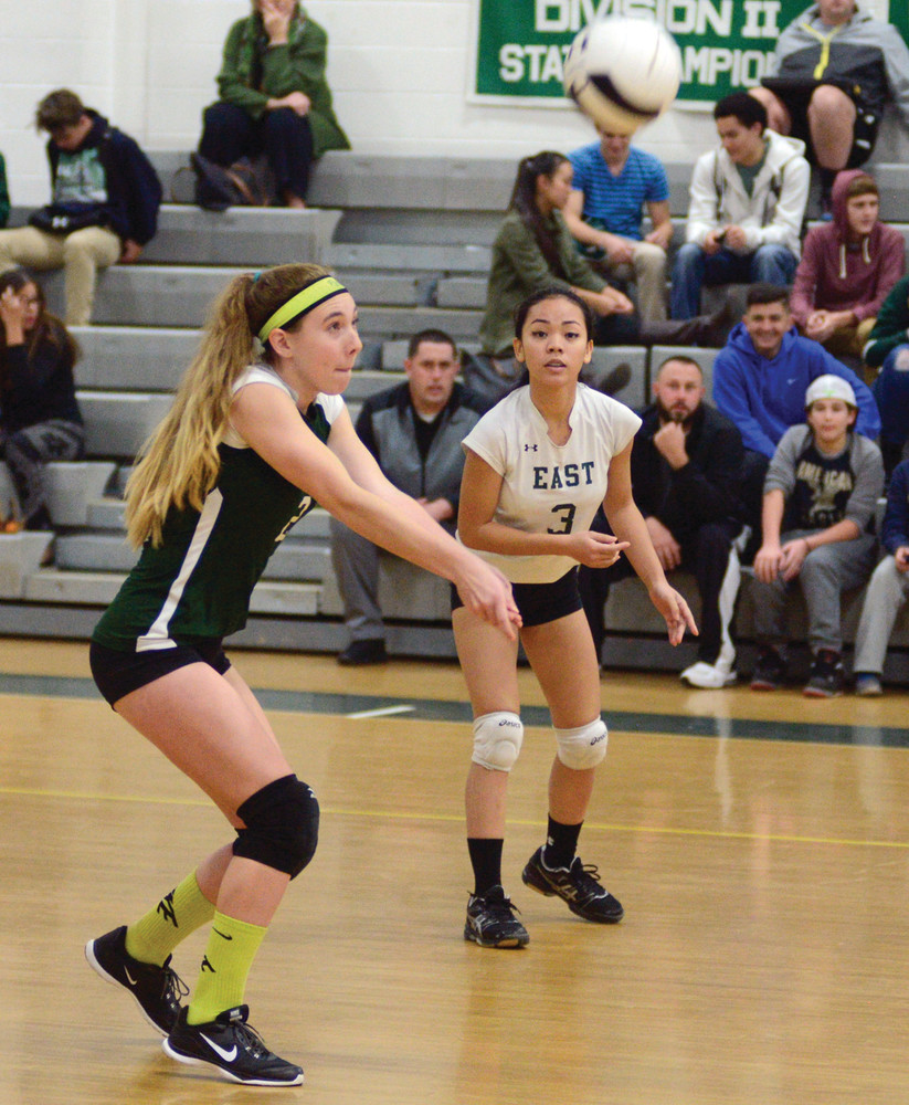 TEAM TO BEAT: Sam Levy's strong serving helped East down Scituate to remain unbeaten.