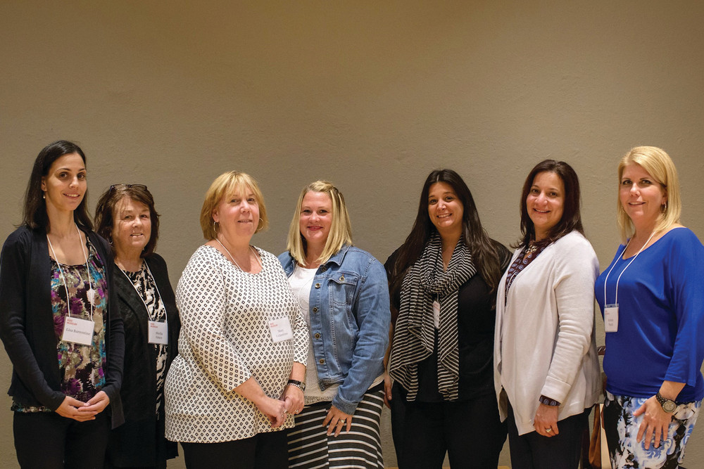 PURSUING ACHIEVEMENT: Twelve Cranston public school teachers have been selected to participate in a new English as a Second Language Instruction training program. Pictured, from left, are Lisa Barrentine, Sheila Grace, Mary Colannino, Dawn Renaud, Mia Acciardo, Superintendent Jeannine Nota-Masse, and Kristin Ward attending the program's kick-off last week.