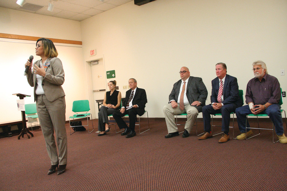CITYWIDE HOPEFULS: From left, Lammis Vargas, Kate Aubin, Council President John Lanni, Councilman Michael Farina, Ken Hopkins, and Louis Petrucci take part in last week's citywide candidates forum at the Cranston Public Library.