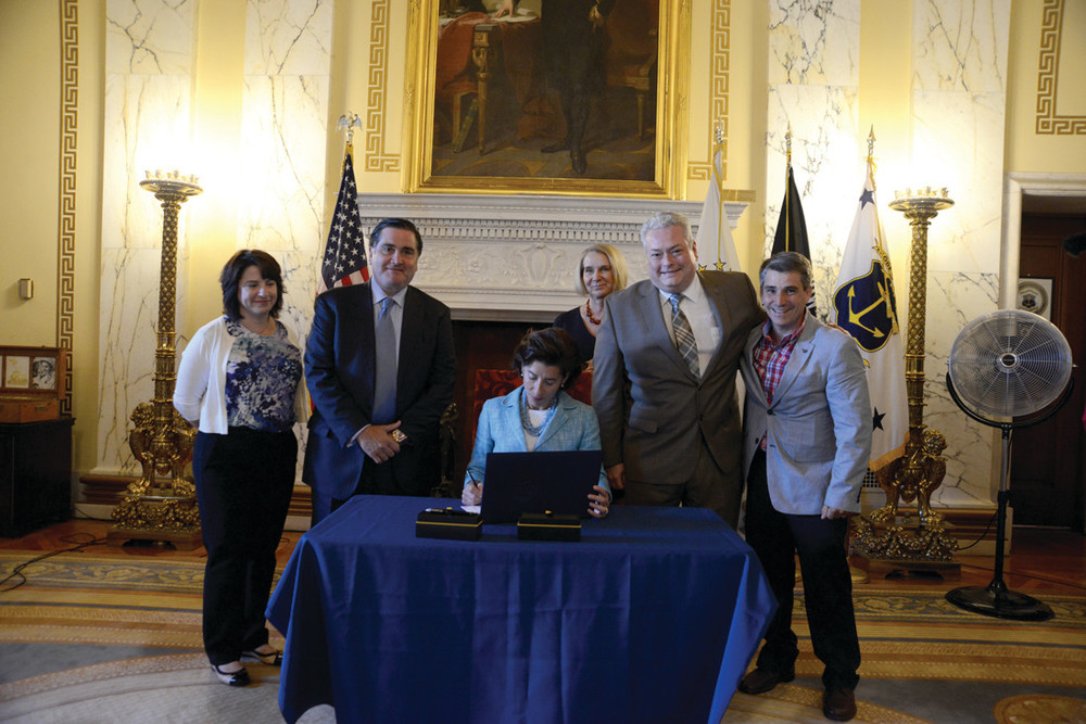 SPECIAL SIGNING:    From left, Sen. Gayle L. Goldin, Sen. Frank S. Lombardi, Gov. Gina M. Raimondo, Sen. Hanna M. Gallo, Rep. William W. O'Brien, and Rep. Kenneth A. Marshall take part in a ceremonial bill signing of the legislation in the State Room of the State House.