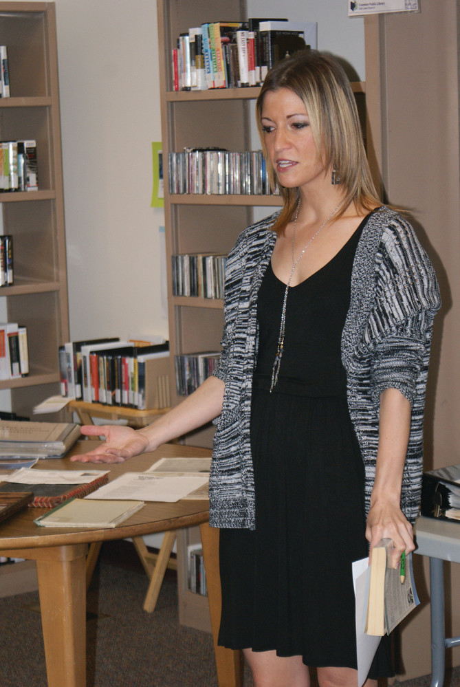EXPLAINING THE UNEXPLAINABLE: Stefanie Blankenship, branch librarian at the Oak Lawn Library, explain the history of the library as well as the phenomena witnessed by herself and others.