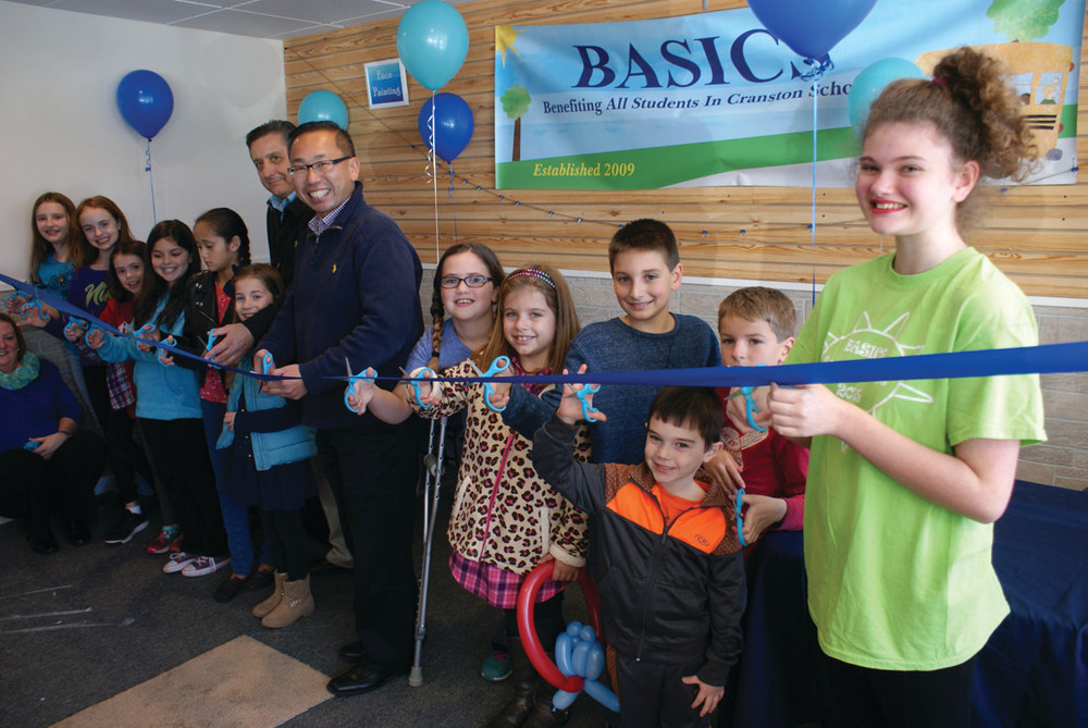 RIBBON CUTTING: Mayor Allan Fung and Ward 6 Councilman Mike Favicchio are seen during the ribbon cutting. Joining them were members of various BASICS programs who had safety scissors to help.