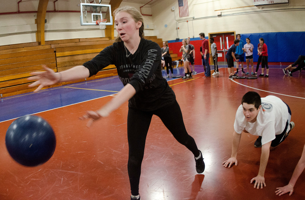 Kelly Conley heaves the giant medicine ball during the race.