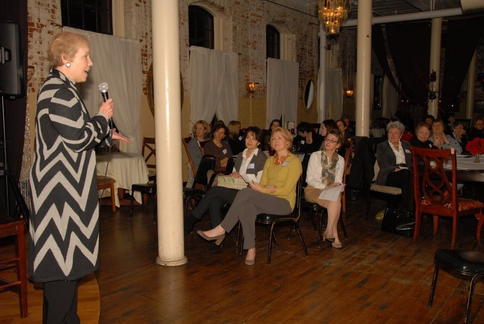 Marilyn Edwards, Co-Founder of 100+ Women Who Care RI, speaking at Hope Artiste Village