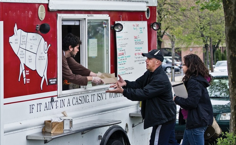Our writer (far right) queues up for Hewtin's Dogs Mobile, the Chez Pascal food truck