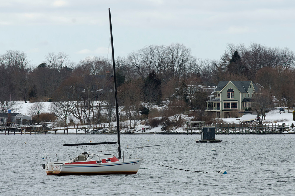 A sailboat is moored in Bristol Harbor. The Town Council voted to put forward an increase in non-profit sailing schools' mooring fees.