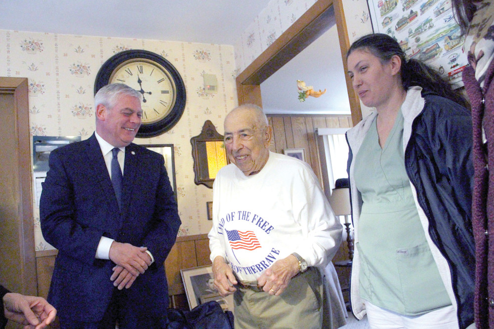 SHARING A STORY: Franks Amalfetano kept Mayor Scott Avedisian laughing and his care giver Juliette Piette smiling with his stories Tuesday when the mayor delivered his Meals on Wheels dinner.