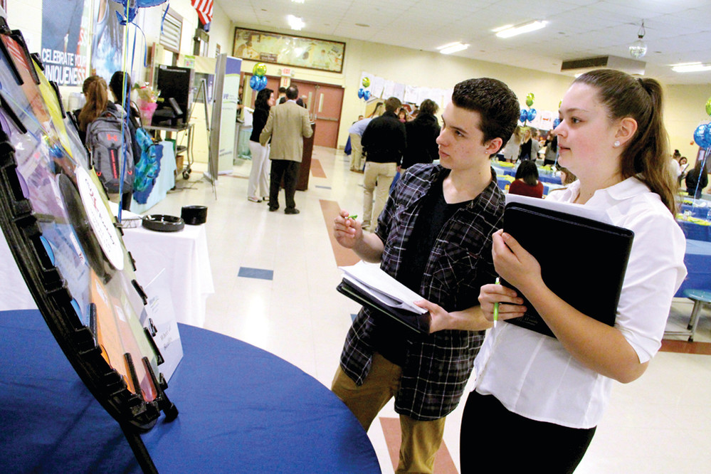 STICKING TO THE BASICS: Toll Gate senior Christian Woods and Eleanor West participated in the sixth annual CU 4 Reality Financial Education Fair held at the school Wednesday by Wave Credit Union. Their budgets didn't include any funds for vacations.