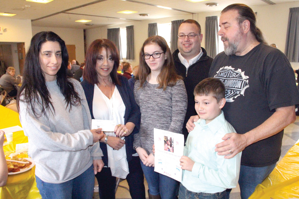 REASON TO SMILE: Ann Corvin, director of the Warwick Animal Shelter (at left), receives a check from Kathy Manders and her family at the Friends of the Warwick Animal Shelter breakfast held Saturday. The funds were raised by the Road Rangers Motorcycle Club in memory of Kathy's daughter, Kristy-Anne Coski. Also pictured are Kathy's granddaughter, Grace Forrester, son, Michael Forrester, grandson Michael Forrester and husband, Peter Manders.