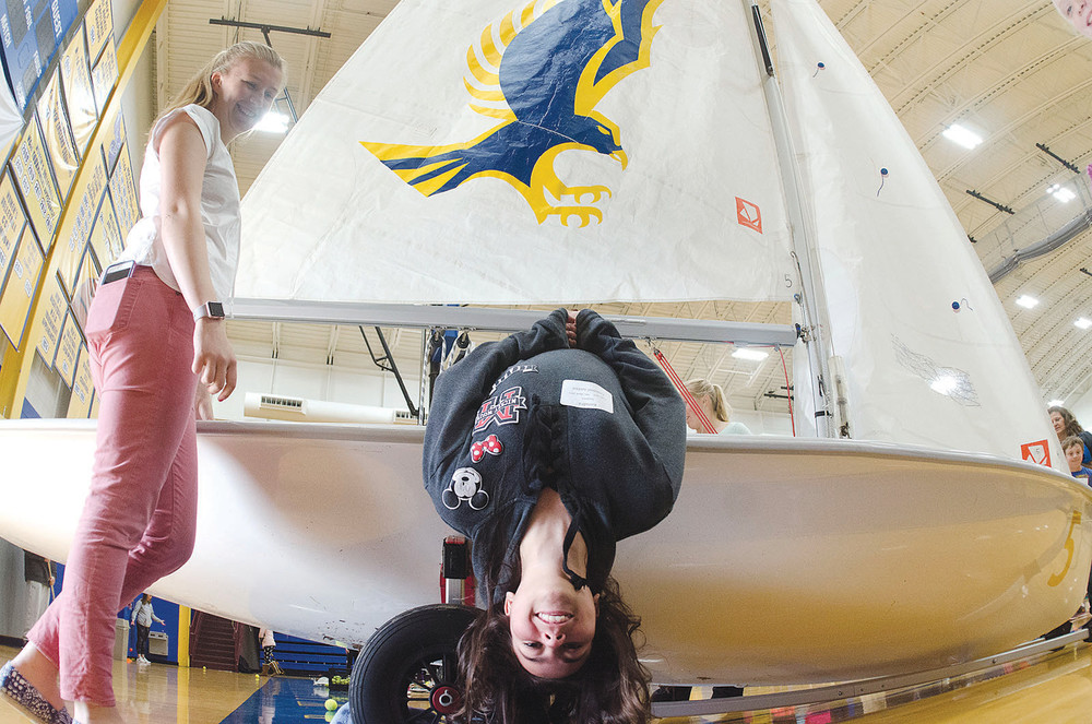 RWU sailor Ariana Smaldone looks on as fifth-grader Kendra Soares simulates a tack during the university's annual Fifth-grade day.