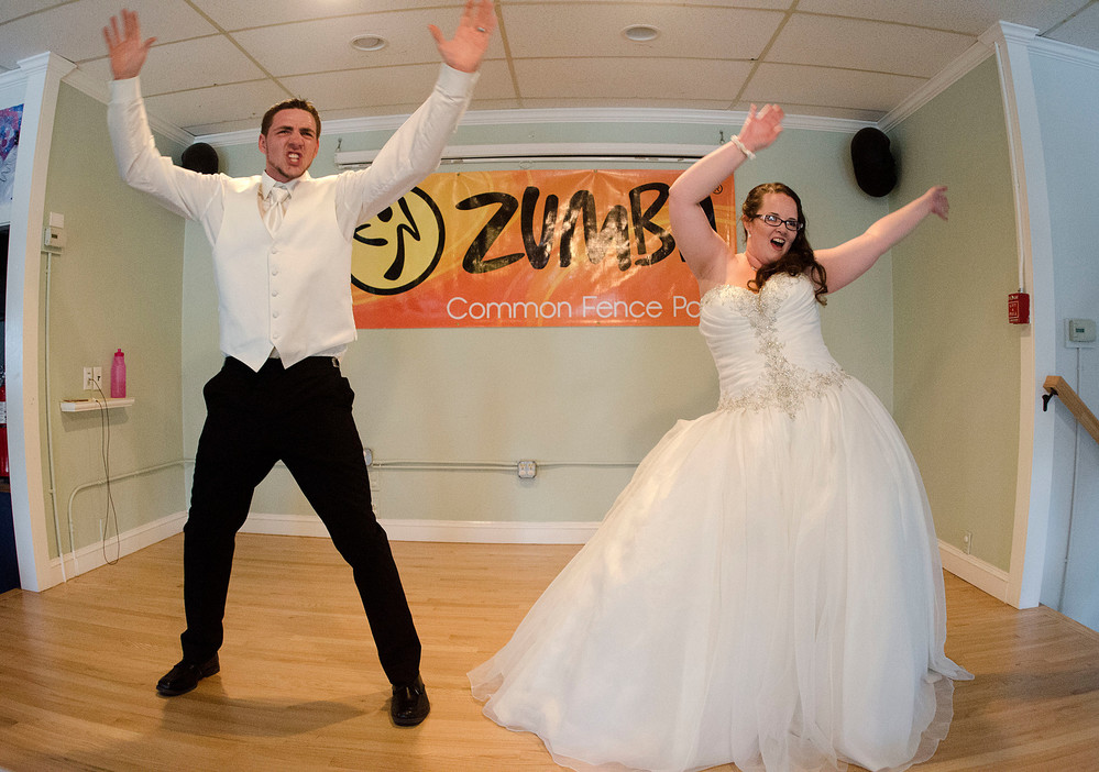 """Newlyweds Justin and Tiffany Bennett dance to """"Lucy"""" during Zumba class at Common Fence Point Community Center after getting married Thursday."""
