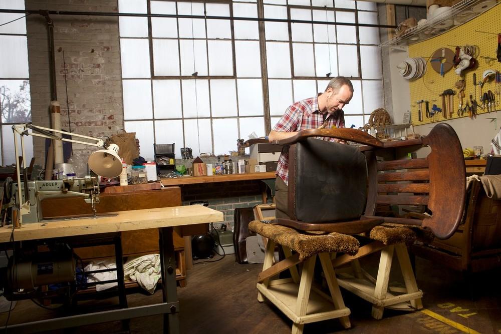 Drew Wheelan reviving an old chair in his studio
