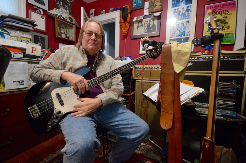 "Ray Davis inside his office and practice room at his Common Fence Point home last week. ""It's the thing I love to do more than anything else,"" he says of playing music."