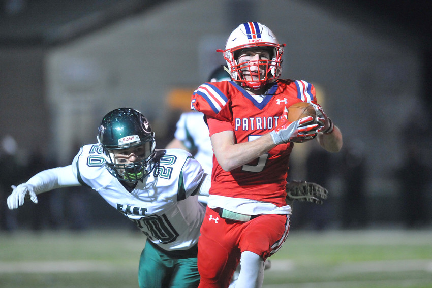 Portsmouth's Brian Hamilton corrals a catch at the start of the third quarter Saturday against Cranston East.
