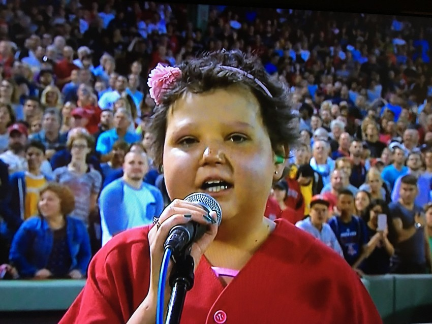 """Hannah Wertens of Portsmouth sings """"God Bless America"""" at Fenway Park in August. You can hear her sing it herself on New Year's Day."""