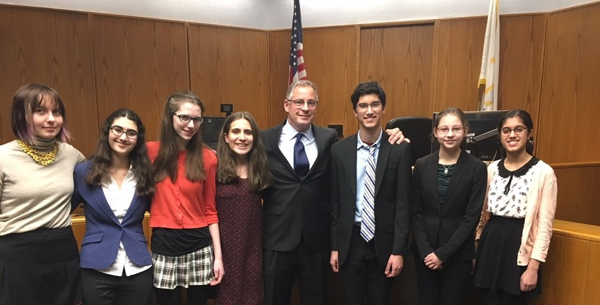 Members of the victorious Barrington High School Mock Trial team included (from left to right) Lila Ackley, Elana Sheinkopf, Clara Kugler, Emily Gorman, Coach Greg Carrara, Amit Bhatia, Rachel Kovach-Fuentes and Anusha Bhatia.