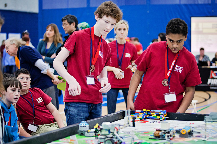Members of The Chundayz team from Portsmouth Middle School watch carefully as their robot moves through the course. From left are Gabe Holmes, Jay Costa, Michael Fahey, Laura Boyle (in back) and Kadden Grant.