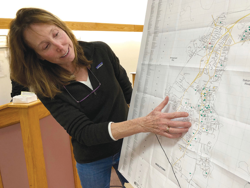 Numi Mitchell, lead scientist of the Narragansett Bay Coyote Study, points to an area on a Portsmouth map where the highest concentration of coyote sightings were reported to police over the past year.