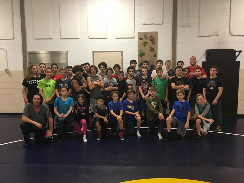 Members of the Barrington Middle School wrestling team pose for a photograph.