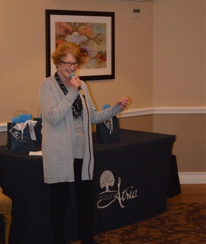 Barrington Library Director Kris Chin shares a story with the crowd at Atria Bay Spring Living.