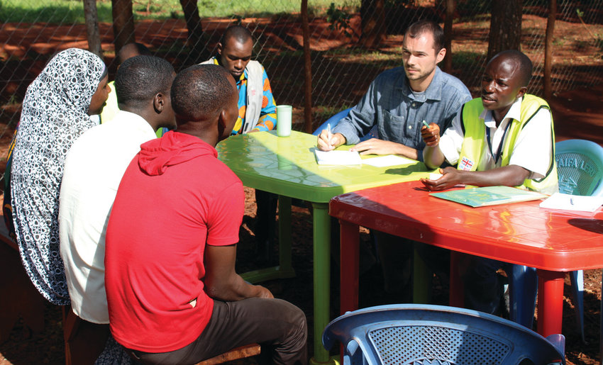 Justin Bibee's extensive experience includes five months spent in Tanzania helping refugees connect to financial institutions.