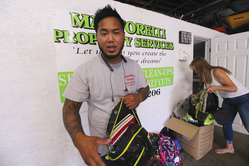 GIVING BACK: Bobby Martorelli, who now operates a successful landscaping business he started with just one lawn mower, was inspired to give back to the local community and is now donating backpacks full of school supplies to families in need.