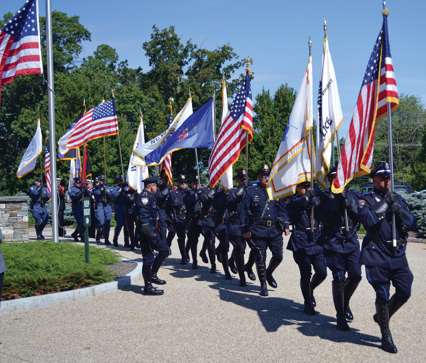 MARCHING OUT: The Honor Guard, comprised of members of several departments including Providence and Cranston, recessed as Monday's ceremony came to a close.