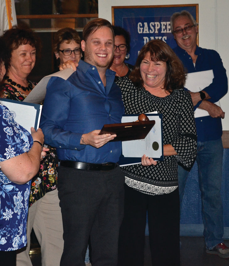 PRESIDENTIAL HONOR: New Gaspee Days Committee president Gina Dooley presented past president Ryan Giviens with a plaque to commemorate his years of service.