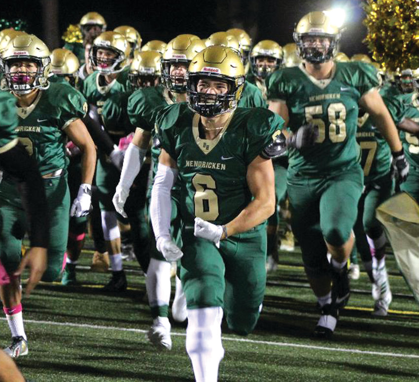 HITTING THE FIELD: The Bishop Hendricken football team takes the field.