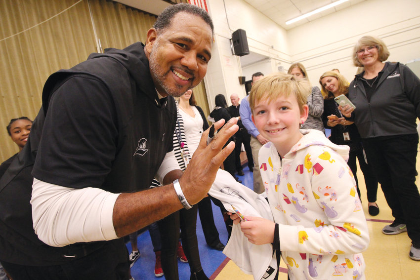 HE COULDN'T MISS HER: There was no question that Norwood second grader Bryna Lemonde is a Friars fan. She had drawn a PC on her cheek and Coach Cooley quickly picked her out of the crowd. They tried to place a surprise call to her father, but he could be reached and they were unable to leave a voice mail.