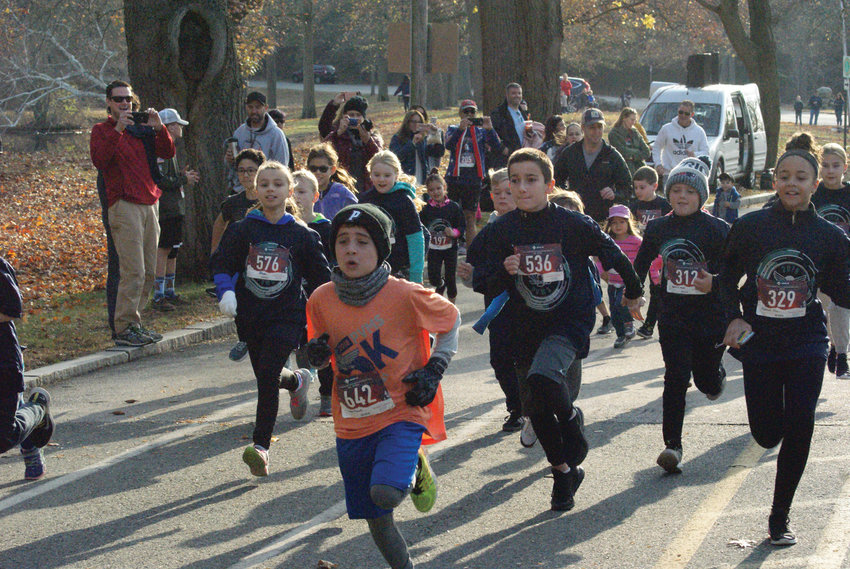 RUN OF HONOR: Park View Middle School hosted its seventh annual Veterans Day 5K event at Roger Williams Park on Monday. Above, Logan Seals of Johnston and other participants are seen at the start line for the 1-Mile Kids Fun Run. Seals went on to win the race with a time of 6 minutes, 27 seconds. For full coverage, turn to Page 6.