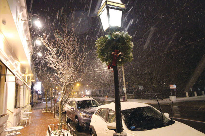 FIRST SNOW: Sunday's snow, albeit not too much of the white stuff, brought a seasonal frosting to Rhode Island – including Pawtuxet Village, which is appropriately decorated for the holidays. Village festivities start this Saturday with the holiday stroll at noon.