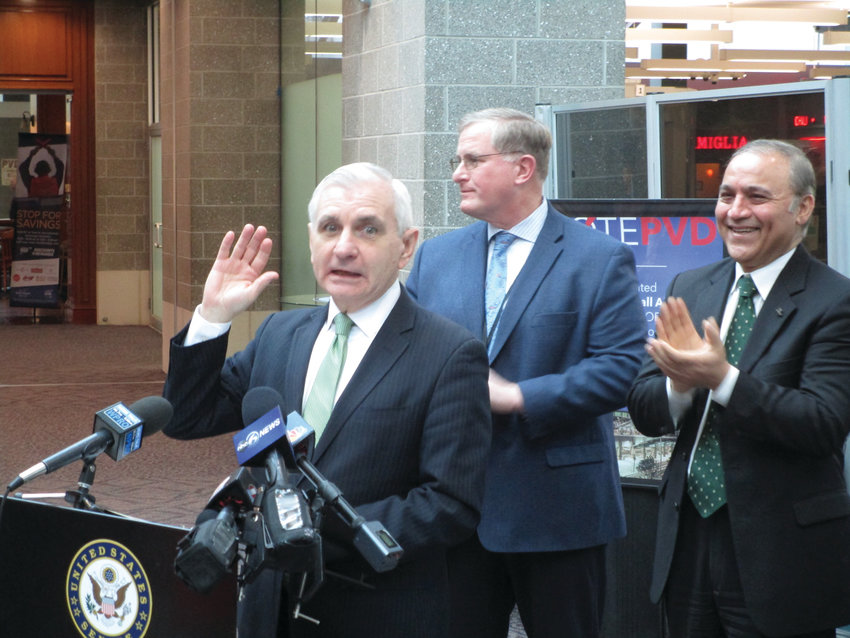 """'BEST IN AMERICA': U.S. Sen. Jack Reed drew applause when he called T.F. Green the """"best airport in America"""" during Friday's press event. Also pictured are TSA Federal Security Director Daniel Burche and Rhode Island Airport Corp. President and CEO Iftikhar Ahmad."""
