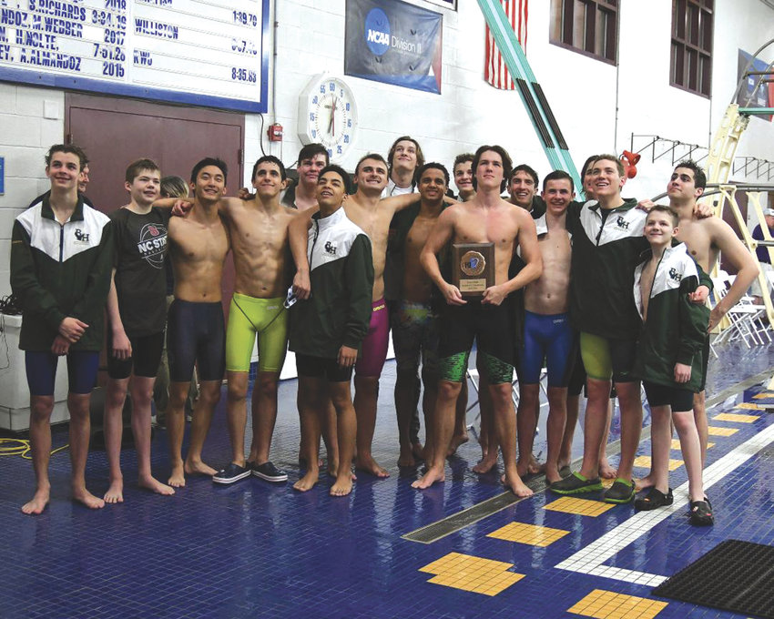 TOP OF THE PODIUM: The Bishop Hendricken swim team.